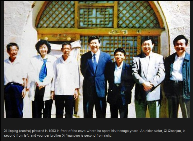Xi Jinping centre pictured in 1993 in front of the cave where he spent his teenage years