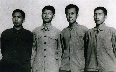 Xi second left as an educated youth volunteer in 1973